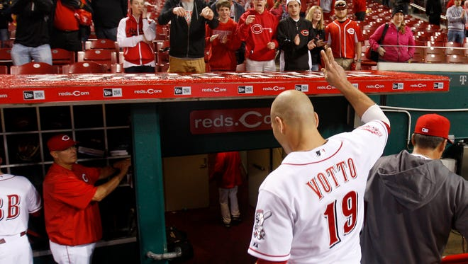 Reds first baseman Joey Votto acknowledges the crowd after singling in the game-winning run in the 11th inning Thursday morning.