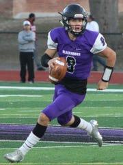 Senior quarterback John Paddock threw for a pair of