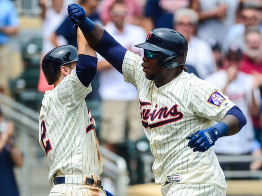 Jul 19, 2017; Minneapolis, MN, USA; Minnesota Twins first baseman Miguel Sano (22) celebrates with second baseman Brian Dozier (2) after hitting a three run home run during the second inning against the New York Yankees at Target Field. Mandatory Credit: Jeffrey Becker-USA TODAY Sports