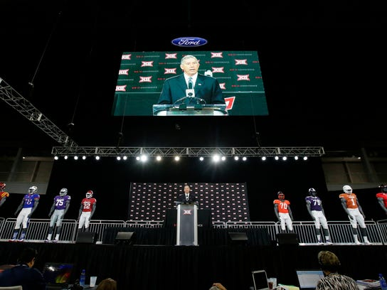 Big 12 commissioner Bob Bowlsby speaks to reporters during the Big 12 NCAA college football media day at the Dallas Cowboys practice facilities in Frisco, Texas, Monday, July 17, 2017. (AP Photo/LM Otero)