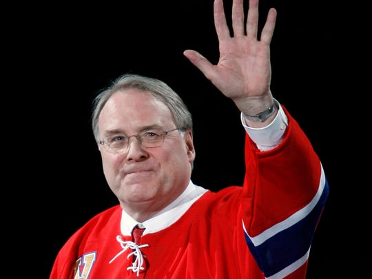 Former Montreal Canadiens goaltender Ken Dryden waves as his jersey is retired in January 2007.