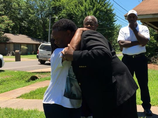 Mayor Jamie Mayo hugs Fannie Williams while discussing the fire that took place at the Williams' home.