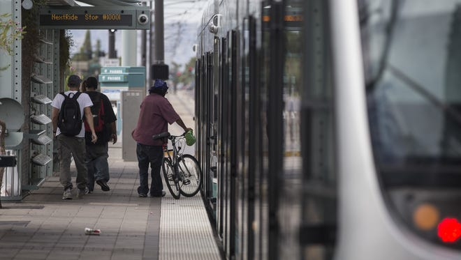 People make their morning commute at the light rail station stop at 19th Ave and Montebello in Phoenix on September 1, 2016 in Phoenix, Ariz.