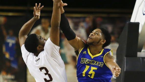 Delaware's Maurice Jeffers blocks a shot by Charleston's
