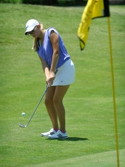 Randi Romack hits a chip shot Tuesday afternoon during