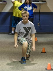 Justin Willever of Allentown, 14, works out at the