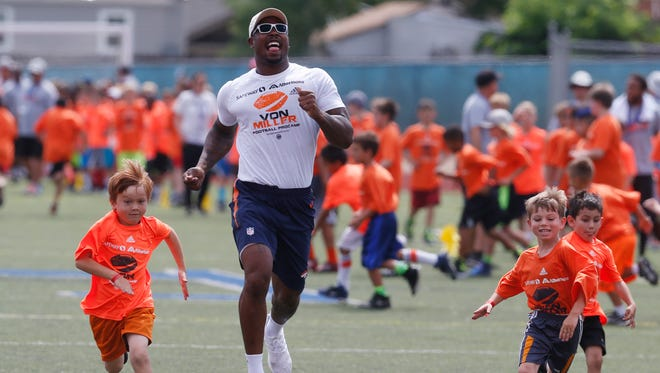 Denver Broncos linebacker Von Miller runs with participants, as the Super Bowl 50 MVP hosted a football camp for kids on at Englewood High School Wednesday, June 22, 2016. Miller is still mired in a contract stalemate with the Broncos.