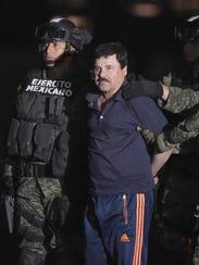 "Drug kingpin Joaquin ""El Chapo"" Guzman is escorted"