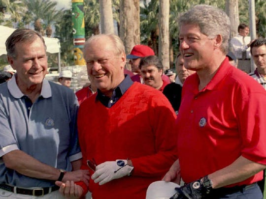 PALM SPRINGS, CA - FEBRUARY 15:  US President Bill Clinton poses for photographers with former presidents George Bush (L),and Gerald Ford 15 February as they prepare for a round of golf at the Indian Wells Country Club where the Bob Hope Classic Golf Tournament is being held.(COLOR KEY:Clinton's shirt is red). AFP PHOTO  (Photo credit should read PAUL RICHARDS/AFP/Getty Images)