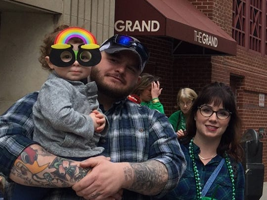 Doug and Laura Esham with their daughter Wren, 2, at the Wilmington St. Patrick's Day Parade on Saturday March 12, 2016.