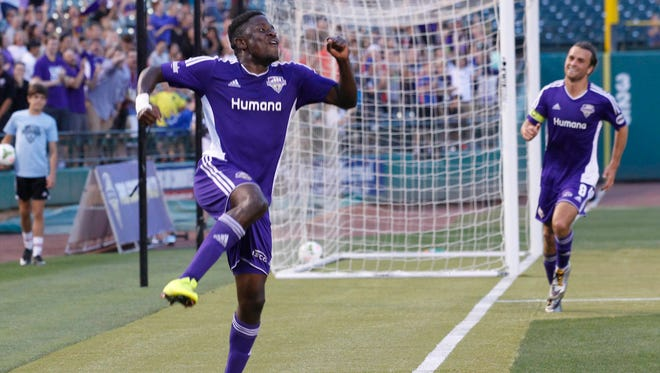 Louisville FC's Kadeem Dacres (7) celebrates after scoring a goal against OKC Energy FC during their game at Louisville Slugger Field in Louisville, Kentucky.         June 27, 2015