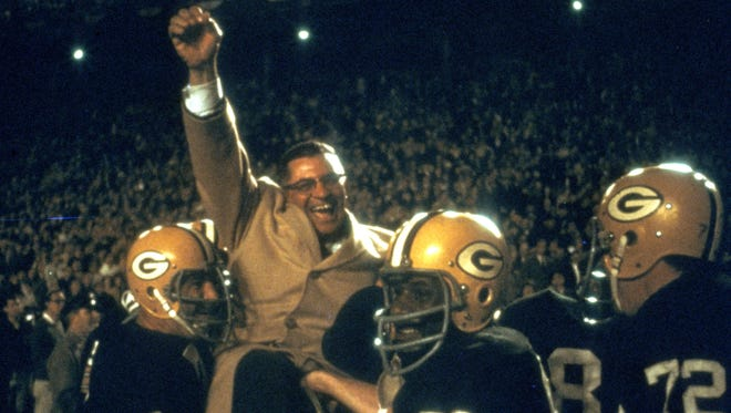 Coach Vince Lombardi is carried off the field after his Green Bay Packers beat the Dallas Cowboys 34-27 in the NFL championship game Jan. 1, 1967 at the Cotton Bowl in Dallas. The Packers went on to beat the Kansas City Chiefs in the first Super Bowl.
