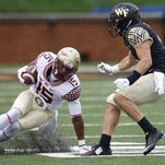 Wake Forest quarterback Kendall Hinton throws the ball against FSU last season. Hinton could be the Deacons full time starter in 2016.