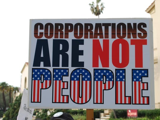-WRTBrd_07-16-2014_Tribune_1_A006~~2014~07~15~IMG_Corporations_are_not_1_1_N.jpg