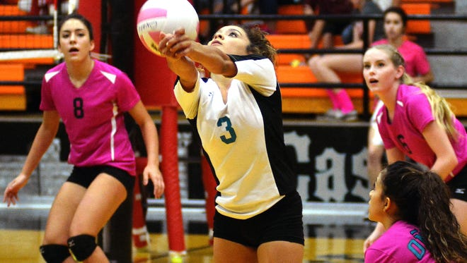 Oñate libero Brandy Hernandez returns a shot by Las Cruces High on Saturday afternoon.