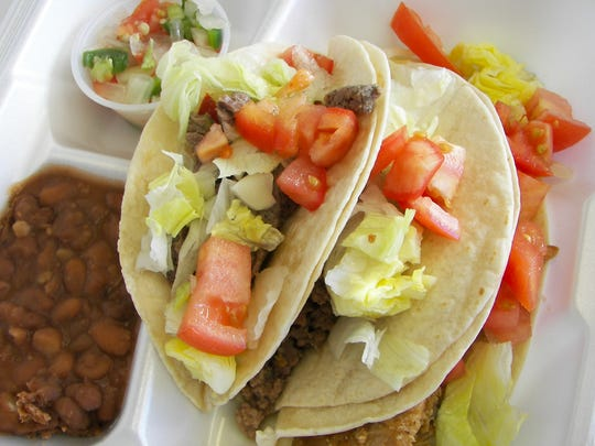 An order of three tacos ($5.99) includes fajita steak, ground beef and chicken, topped with lettuce, tomato and onion, plus refried beans and pico de gallo on the side.