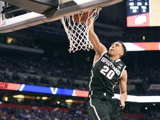 MSU's Travis Trice throws down a dunk late against