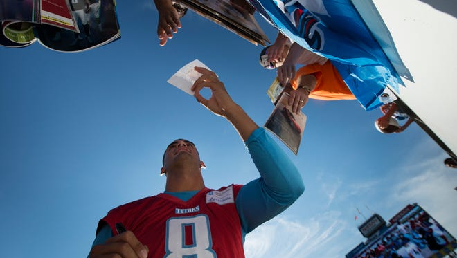 Titans quarterback Marcus Mariota (8) signs autographs for fans before a training camp scrimmage at Nissan Stadium on Saturday, Aug. 5, 2017.