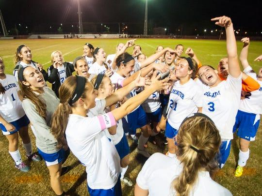 The Stephen Decatur girls soccer team celebrates taking