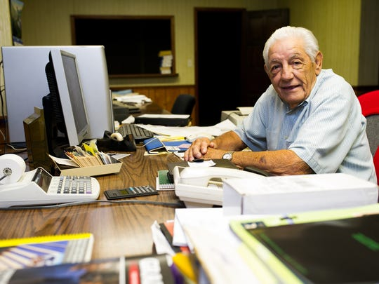 Pete Ciampa is photographed in his office in Fort Myers. Pete Ciampa is senior vice president/construction for Michigan Homes Inc. He's 84 and has been with the company since 1956.