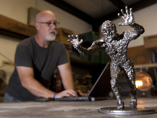 Dan Strode, left, and Mark Leonard of Machine Brothers create machine age pieces from recycled and donated parts. Photo taken on Tuesday, May 26, 2015.