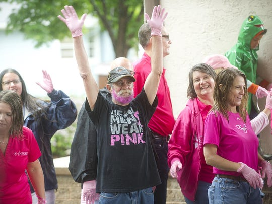 Bob Roblee of Eldorado shows his support during Agnesian HealthCare's Pink Glove Dance 2015. The pouring rain didn't dampen spirits.