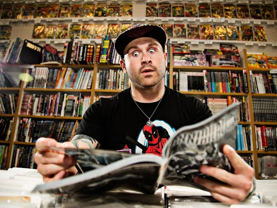 """Brad Roenfeld, 24 of Glenwood, works at Jay's CD and Hobby store at the Valley West Mall in West Des Moines. There is always a big nostalgia factor Roenfeld said about reading comics, """"It brings back memories of how much fun you had as a kid."""""""