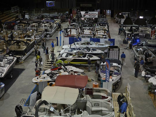 Festivalgoers attend the WBAY Boat Show on Friday at Shopko Hall and Brown County Veterans Memorial Arena in Ashwaubenon on Feb. 20. It's one of the many uses of the old arena.