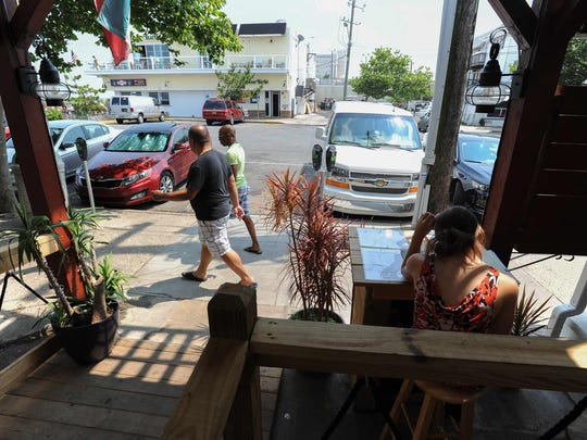 Car and foot traffic outside Zogg's Raw Bar and Grill in Rehoboth Beach.