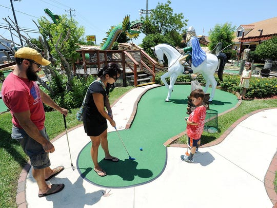 The Prausas from Simsbury, Conn., play miniature golf at Viking Golf at the corner of Coastal Highway (Del.1) and Del. 54 in Fenwick Island.