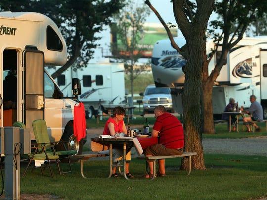 Tourists enjoy dinner at Sioux Falls KOA, a campsite and RV park along Interstate 90 near Cliff Avenue.