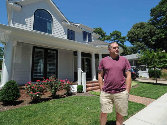 Dave McCarthy, a real estate agent and home builder, on Friday stands in front of a house in Rehoboth Beach he constructed. Rehoboth Beach officials are exploring moves to rein in the size of homes being built.