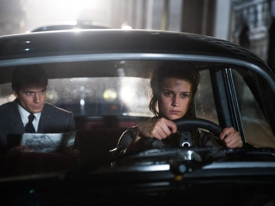 """Henry Cavill and Alicia Vikander star in """"The Man from U.N.C.L.E."""""""