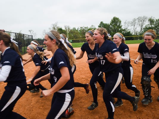 Dallastown players rush to hug their coach after securing their 6-3 win over Susquehannock on Wednesday night May 14, 2014 at New Oxford High School in the YAIAA softball title game. Shane Dunlap - GameTimePA.com