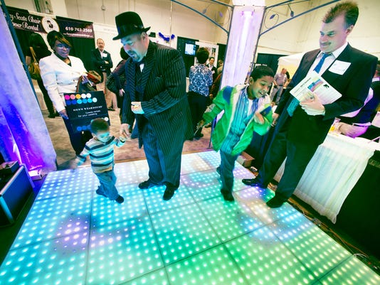 From the left, Monique McGraw looks on as her grandson Messiah, age 3, dances with her financee Keith Ritz. of Dover, as her son Basheer, age 10, also dances and vendor Matt Saltzer, of Rhythm System Pro D.J. Entertainment of New Cumberland looks on.                   YORK DAILY RECORD/SUNDAY NEWS - PAUL KUEHNEL