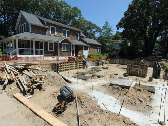 The foundation is set in July for the home shown above on Rodney Street in Rehoboth Beach.