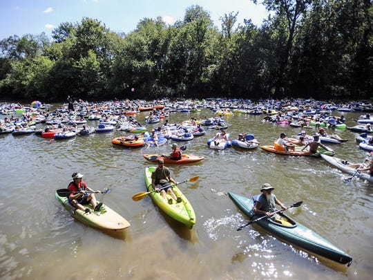 Last September, 548 people took to the French Broad River in an attempt to set the Guinness World Record for the most people floating in a line. They're pictured here with a cadre of safety boaters. (Kayaks don't count toward the record.)