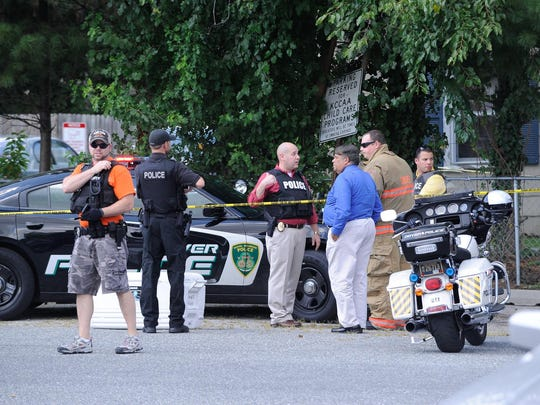 Police investigate a shooting Friday near South Governors Avenue in Dover.