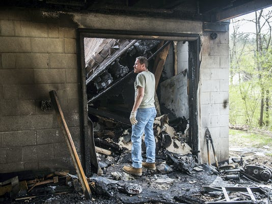 North Codorus Township resident Stephen Smith surveys the damage to his home after a fire on April 19.