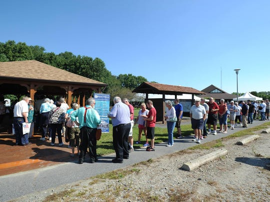 People line up to buy Delaware's America the Beautiful series quarter Friday at Bombay Hook National Wildlife Refuge near Smyrna.