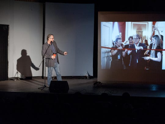 """Shane Guffogg speaks to Lindsay middle school students on Thursday, November 19, 2015 about his life as a fine artist from his beginning in Lindsay to his most recent show, pictured at right, """"The Observer is the Observed"""" featuring 73 paintings and 3 glass sculptures at the Imperial Academia National Museum in St. Petersburg, Russia. Guffogg is returning to his hometown for a gallery opening."""