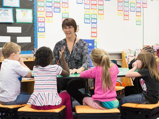 Peggie Bosso works with students in her kindergarten class Oct. 7 at Oakcrest Elementary School. Quint and Rishy Studer are offering a total of $50,000 for ideas on how to improve kindergarten readiness in Escambia County