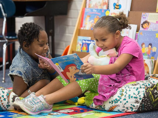 Moriah Griffin and Caterina Powell read in Peggie Bosso's kindergarten class at Oakcrest Elementary School in October.