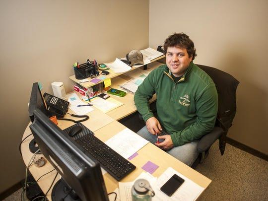 Nate Besich, an environmental engineer, works on environmental