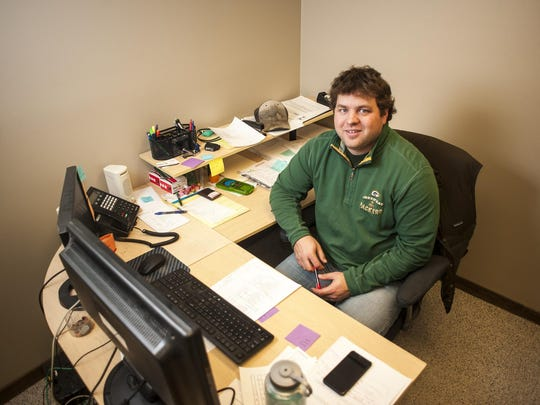 Nate Besich, an environmental engineer, works on environmental site assessments at Big Sky Civil and Environmental.