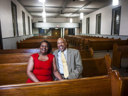 Pastors Alice and Robert Lewis sit in a pew in the remodeled sanctuary.