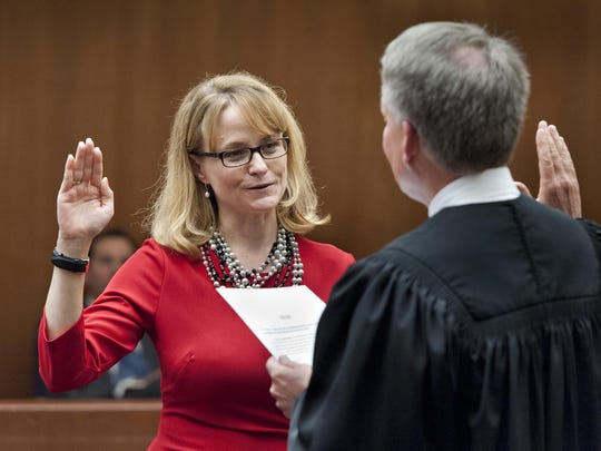 Judge Tara K. Howard takes the oath of office publicly