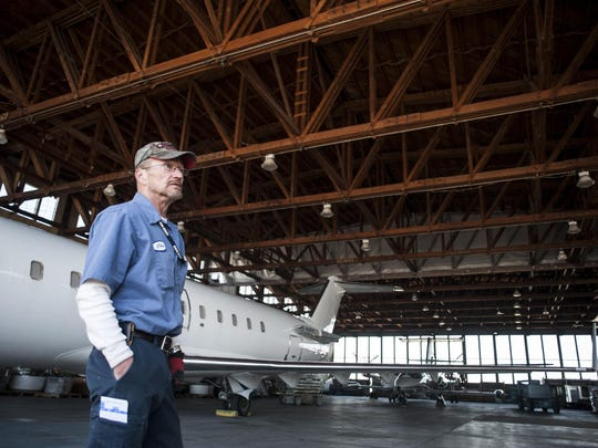 Chris Nelson, a lead mechanic for Avmax, describes how the wooden World War II hangar was constructed and is now used by the jet maintenance company for storage at Great Falls International Airport.