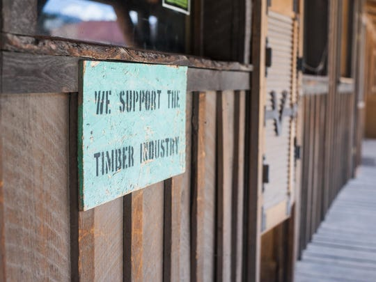 A sign declaring Darby's support for the timber industry hangs on a Main Street storefront.