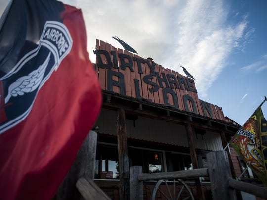 "Military flags wave outside the Dirty Shame, noting the owner's past as an Army Ranger. John Runkle let's it be crazy, to a point. ""The Dirty Shame has always been one of the wildest bars in Montana and bringing it back has helped that – it's a controlled wild,"" he said."